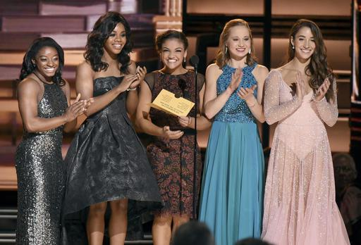 Olympic gymnasts, from left, Simone Biles, Gabby Douglas, Laurie Hernandez, Madison Kocian and Aly Raisman present the award for single of the year at the 50th annual CMA Awards at the Bridgestone Arena on Wednesday, Nov. 2, 2016, in Nashville, Tenn. (Photo by Charles Sykes/Invision/AP)